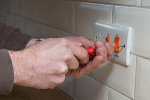 property-maintenance-man-fixing-socket-700x467